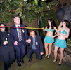 Staff and clients of Lawrence Graham, a firm of solicitors, join limbo dancers at the Rainforest Café, London. November 2002