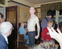 A bare-chested skinhead postures in a pub in the Lancashire town of Bacup. April 2001