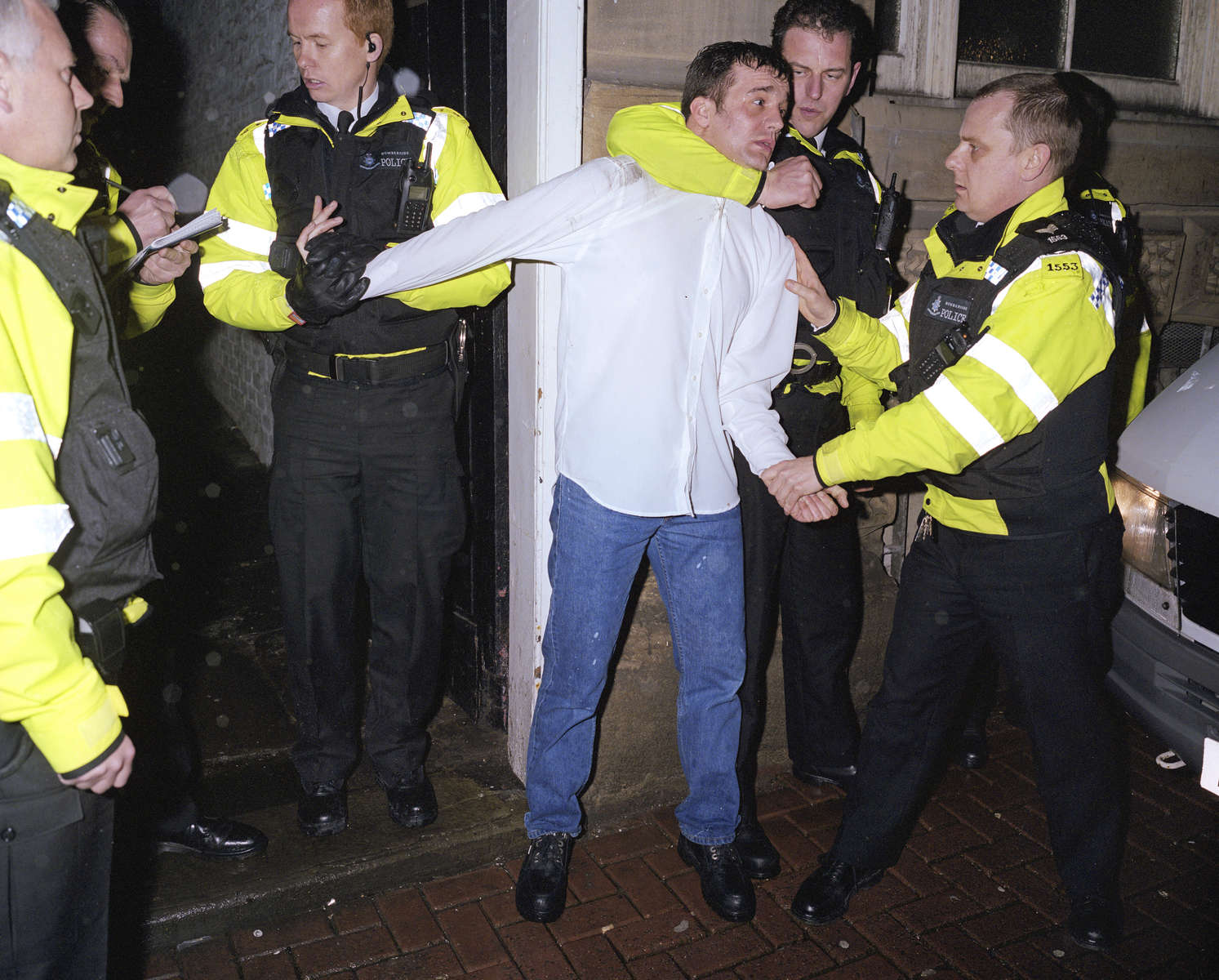 Humberside Police officers restrain a man suspected of causing a public order offence while under the influence of alcohol. April 2004
