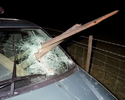 Near Bristol a car has crashed into a fence on a country road; the driver was suspected of being under the influence of alcohol. November 2001