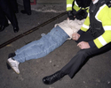 A young man is restrained by police officers after they intervene to break up a fight outside a kebab shop on Union Street in Plymouth. November 2001