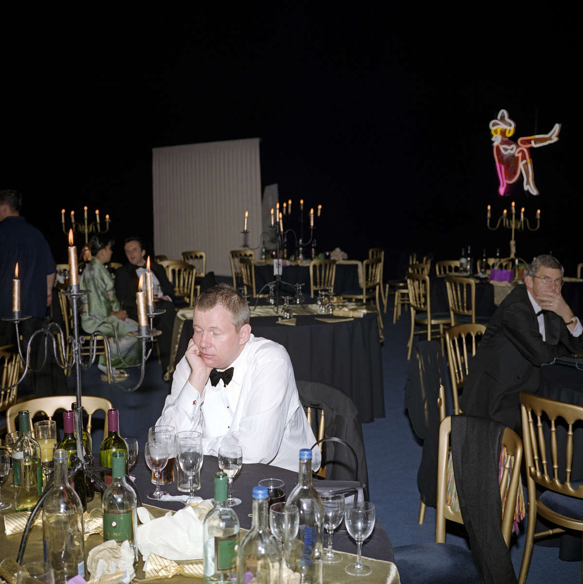 A guest at the Systems Union Las Vegas-themed party rests his eyes after dinner in a marquee in Farnborough. November 2002