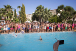 16:43 British seasonal workers and tourists in Ayia Napa, Cyprus, pose for a group photograph by the outside pool, during an afternoon pool party at Club Aqua.