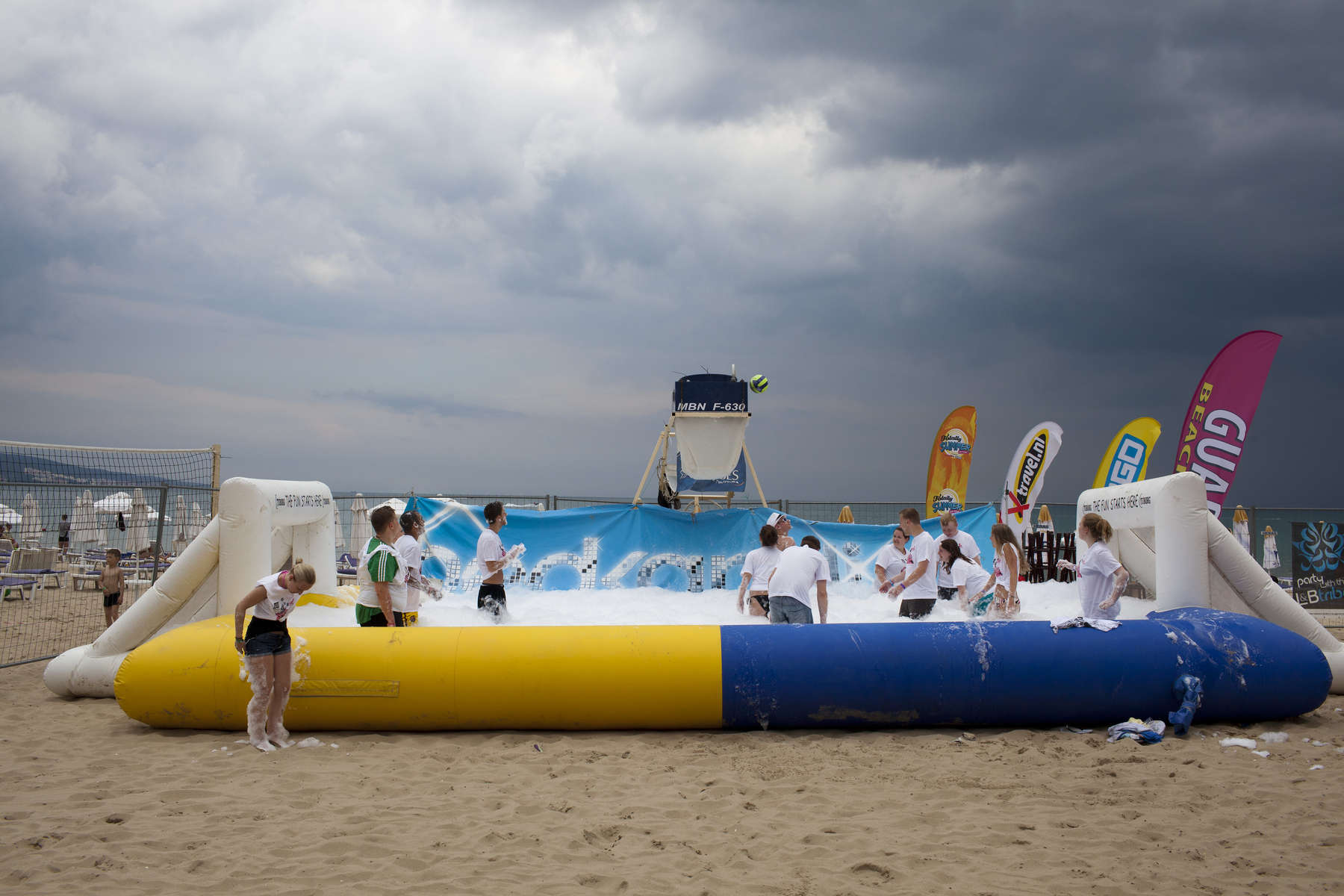 15: 54 An inflatable pool with goals at either end is filled with foam on the beach for a party organised at Sunny Beach, Bulgaria, by promotional entertainments team, The Party Crew. Enjoying the foam, among others, are friends from Norwich, Triston and Tom, with their girlfriends Danielle and Vicky.