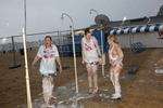15:33 19 year old students Kelly (centre) and Paige (right) from Stoke, shower foam from themselves after attending a party organised by The Party Crew at Guaba Beach Bar, Sunny Beach, Bulgaria.