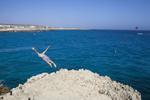 16:42 A British man swallow dives into the sea from a cliff near Nissi Beach, Ayia Napa, Cyprus.