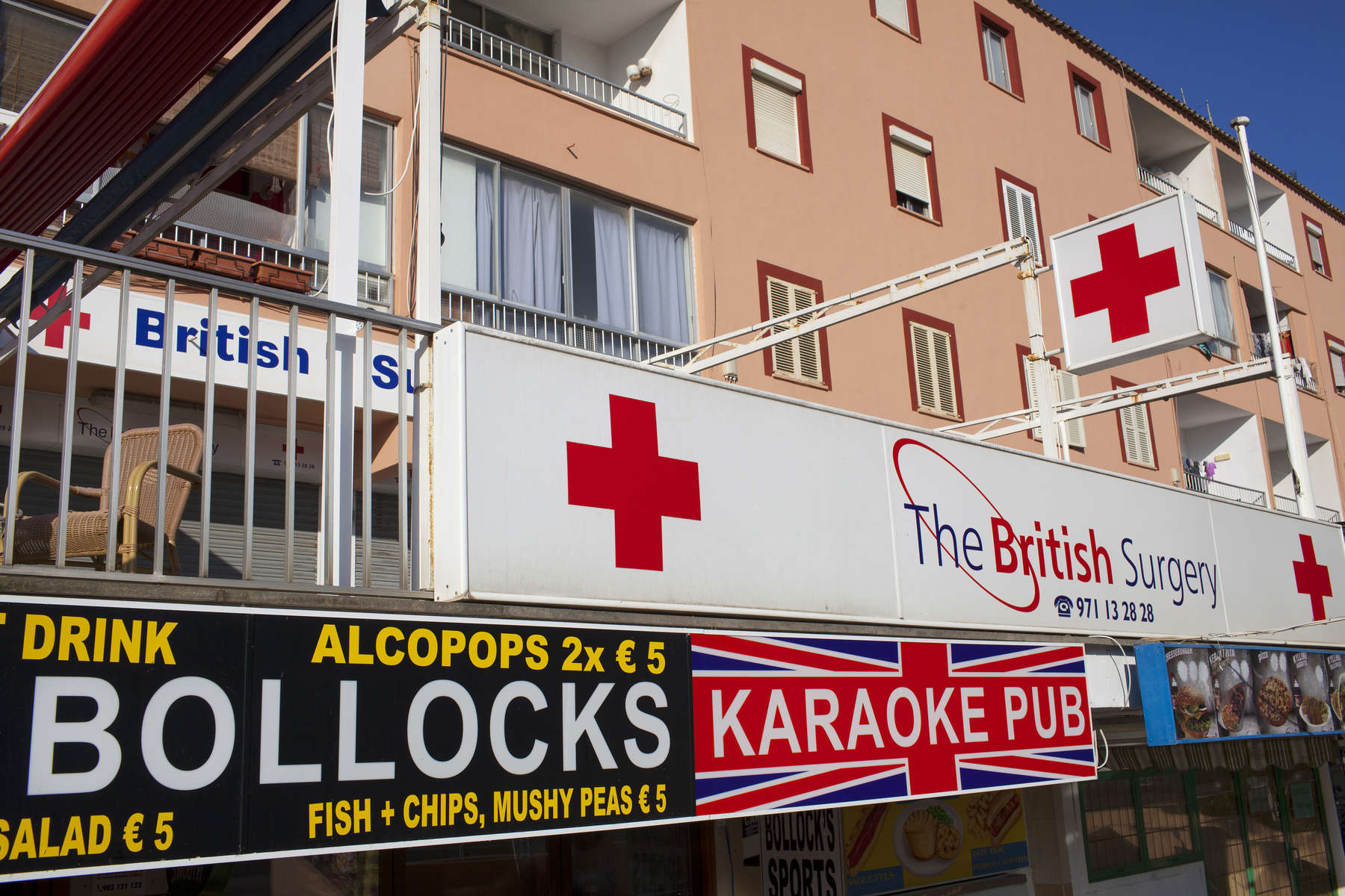 The British Surgery located above the Green Parrot Bollocks Bar in Magaluf, Majorca. The bars and clubs in the resort largely cater for British tourists.