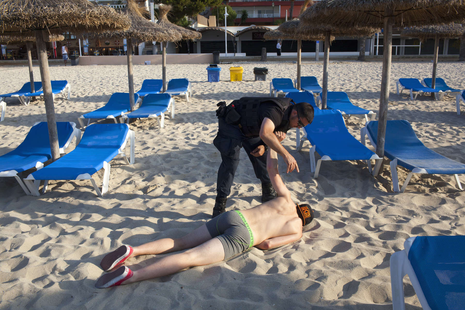 08:04 32 year old security officer George, tries to wake a British man found slumped on the beach in Magaluf, Majorca. George works a nine hour shift, seven days a week, five months a year. He patrols the beach alone, armed with only a baton and five years experience. At around 06:30 each morning, George starts to clear the beach of people who have chosen to sleep there or who have collapsed on it.