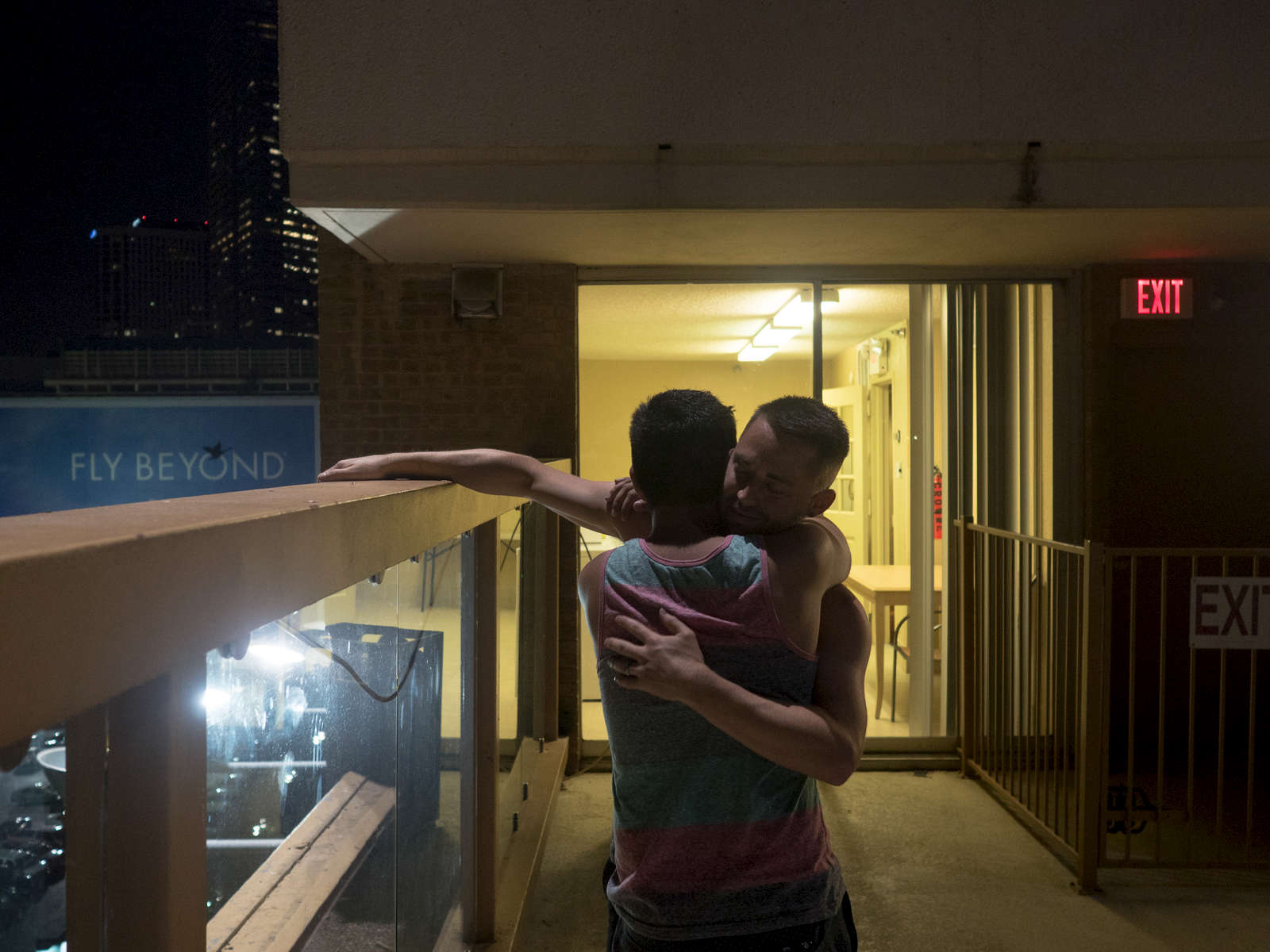 A same sex couple embrace after agreeing to get married; same-sex marriage became a legal right across America on the 27th June 2015.Dallas is a major city in Texas and is the largest urban center of the fourth most populous metropolitan area in the United States. The city ranks ninth in the U.S. and third in Texas after Houston and San Antonio. The city's prominence arose from its historical importance as a center for the oil and cotton industries, and its position along numerous railroad lines.For two weeks in the summer of 2015, photographer Peter Dench visited Dallas to document the metroplex in his epic reportage, DENCH DOES DALLAS.Photographed using an Olympus E-M5 Mark II©Peter Dench/Getty Images Reportage