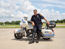 Motorcycle unit police officer Mike J Mitchell volunteers at the basic day training of the Dallas Junior Police Academy. His Harley Davidson bike weighs around 850lb and can do 110 miles an hour; he has been in the police for 26 years and hopes to retire in two.Dallas is a major city in Texas and is the largest urban center of the fourth most populous metropolitan area in the United States. The city ranks ninth in the U.S. and third in Texas after Houston and San Antonio. The city's prominence arose from its historical importance as a center for the oil and cotton industries, and its position along numerous railroad lines.For two weeks in the summer of 2015, photographer Peter Dench visited Dallas to document the metroplex in his epic reportage, DENCH DOES DALLAS.Photographed using an Olympus E-M5 Mark II©Peter Dench/Getty Images Reportage