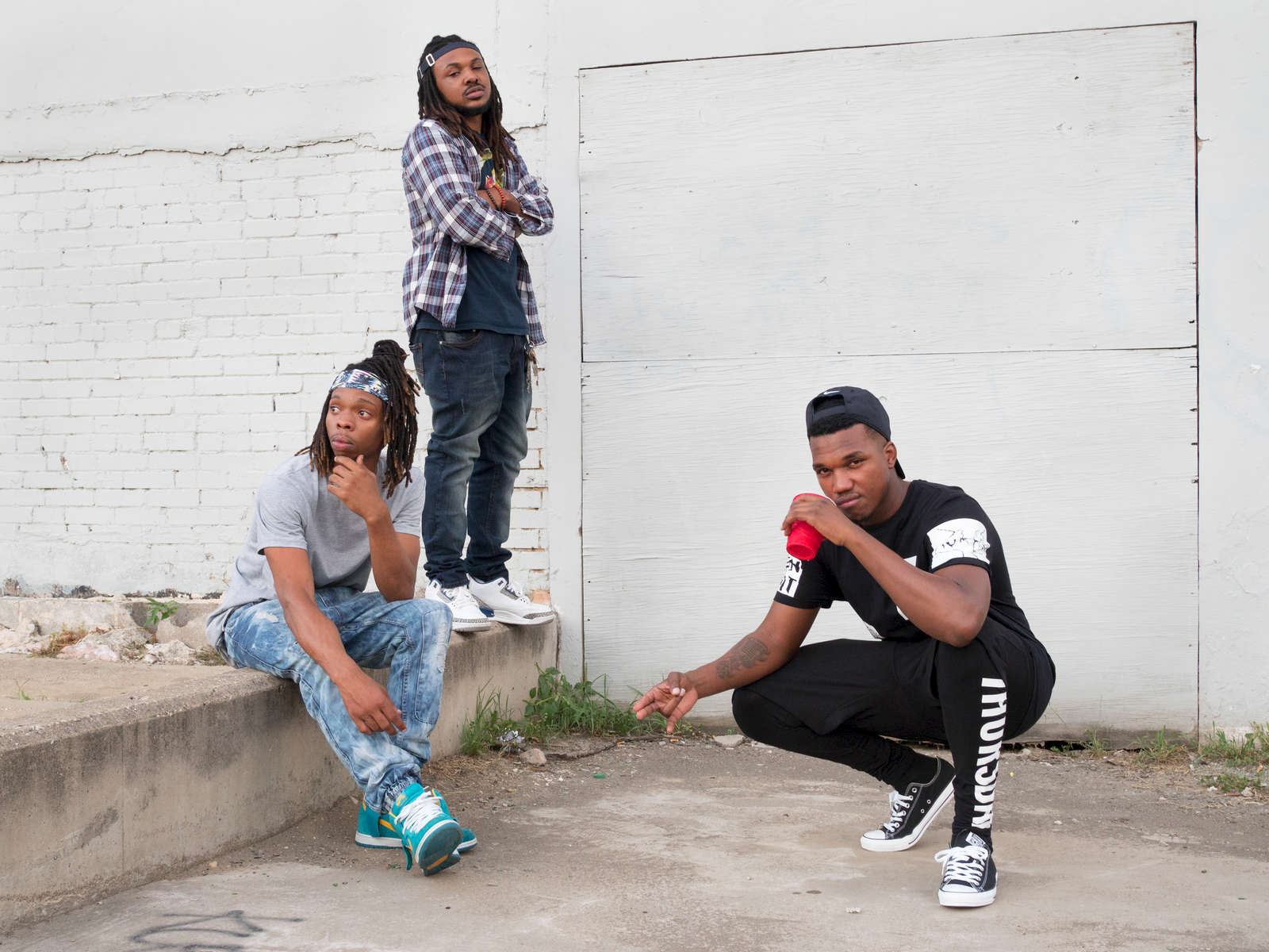 The Yung Stonerz, a musically inclined collective from Louisiana, pose for a photograph before a gig in Deep Ellum, a neighborhood composed largely of arts and entertainment venues near downtown in Old East Dallas.Dallas is a major city in Texas and is the largest urban center of the fourth most populous metropolitan area in the United States. The city ranks ninth in the U.S. and third in Texas after Houston and San Antonio. The city's prominence arose from its historical importance as a center for the oil and cotton industries, and its position along numerous railroad lines.For two weeks in the summer of 2015, photographer Peter Dench visited Dallas to document the metroplex in his epic reportage, DENCH DOES DALLAS.Photographed using an Olympus E-M5 Mark II©Peter Dench/Getty Images Reportage