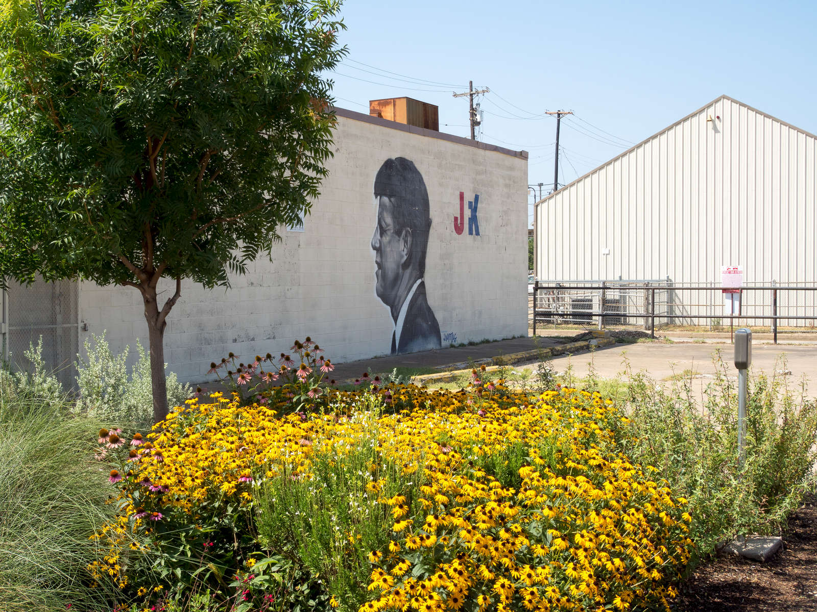 A murel of 35th President of the United States, John F. Kennedy on a wall in south Dallas, the city where he was assasinated.Dallas is a major city in Texas and is the largest urban center of the fourth most populous metropolitan area in the United States. The city ranks ninth in the U.S. and third in Texas after Houston and San Antonio. The city's prominence arose from its historical importance as a center for the oil and cotton industries, and its position along numerous railroad lines.For two weeks in the summer of 2015, photographer Peter Dench visited Dallas to document the metroplex in his epic reportage, DENCH DOES DALLAS.Photographed using an Olympus E-M5 Mark II©Peter Dench/Getty Images Reportage