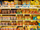 Crisps for sale in a supermarket in the Richardson district of Dallas.Dallas is a major city in Texas and is the largest urban center of the fourth most populous metropolitan area in the United States. The city ranks ninth in the U.S. and third in Texas after Houston and San Antonio. The city's prominence arose from its historical importance as a center for the oil and cotton industries, and its position along numerous railroad lines.For two weeks in the summer of 2015, photographer Peter Dench visited Dallas to document the metroplex in his epic reportage, DENCH DOES DALLAS.Photographed using an Olympus E-M5 Mark II©Peter Dench/Getty Images Reportage