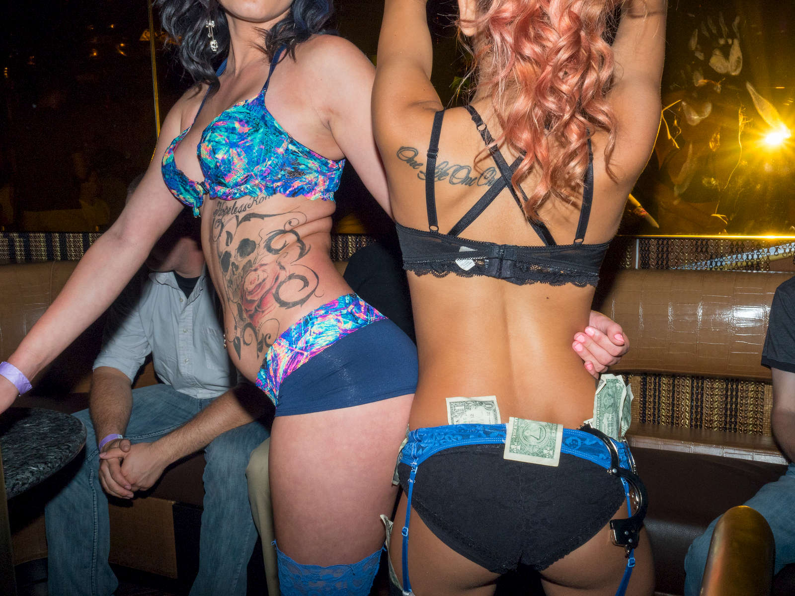 Young guests at a lingerie theme night hosted at Thrive nightclub located in the Crowne Plaza hotel on Elm street, downtown Dallas.Dallas is a major city in Texas and is the largest urban center of the fourth most populous metropolitan area in the United States. The city ranks ninth in the U.S. and third in Texas after Houston and San Antonio. The city's prominence arose from its historical importance as a center for the oil and cotton industries, and its position along numerous railroad lines.For two weeks in the summer of 2015, photographer Peter Dench visited Dallas to document the metroplex in his epic reportage, DENCH DOES DALLAS.Photographed using an Olympus E-M5 Mark II©Peter Dench/Getty Images Reportage