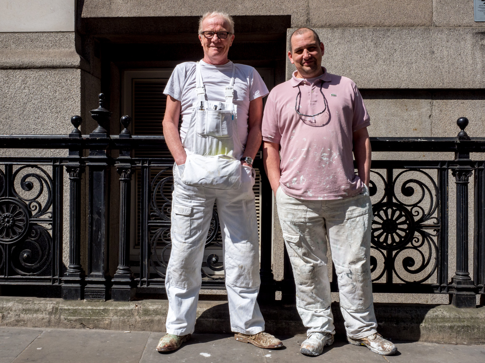 67 year old Bill (left) and Spencer (43), both painters from London, aren't worried about their jobs. St Martin's-le-Grand, London.