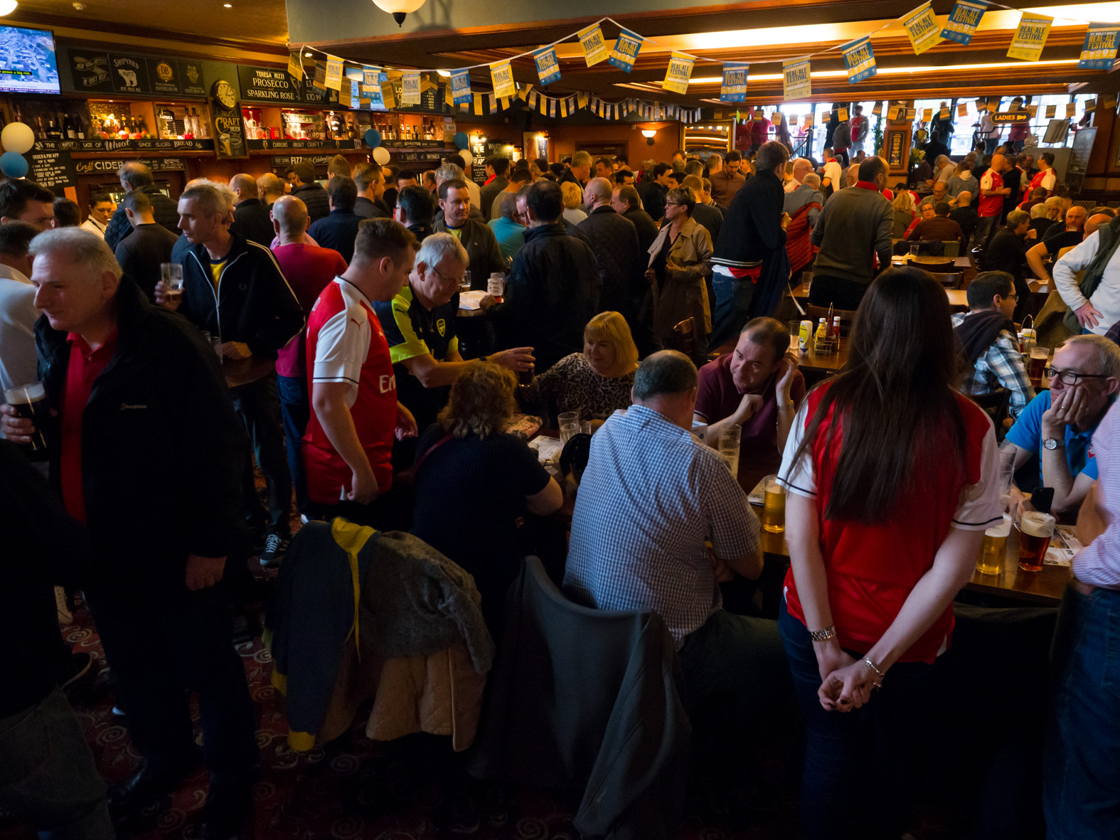 Arenal football club fans in The Coronet pub on match day. Holloway, London.
