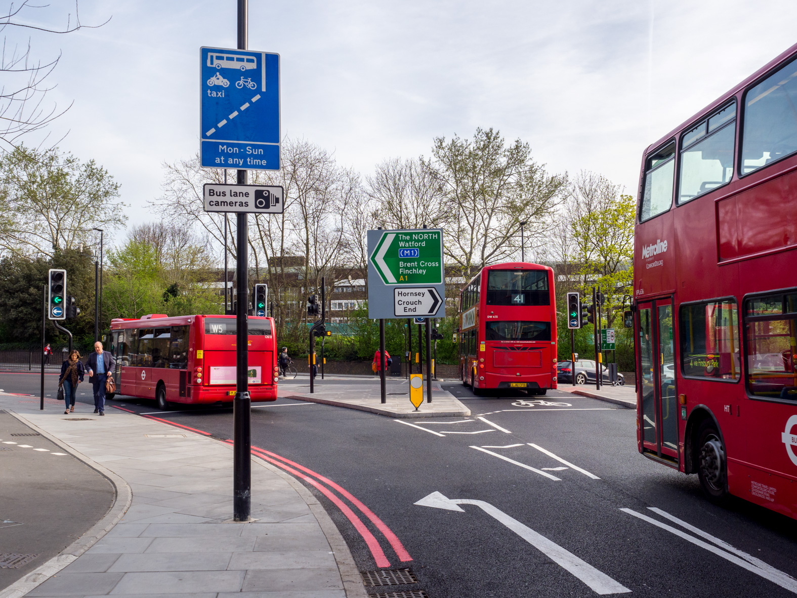 A single decker bus travels north on the A1. Archway, London.
