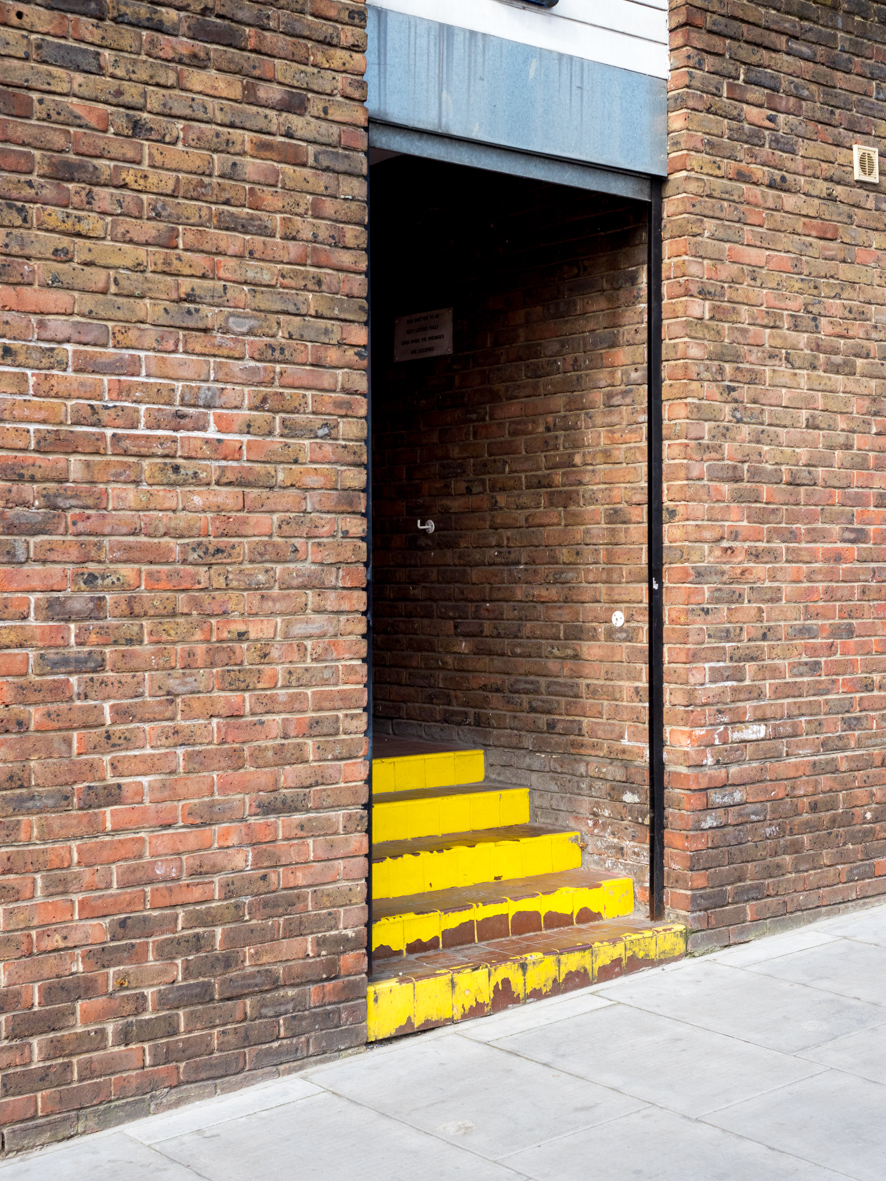 Yellow steps. Archway, London.
