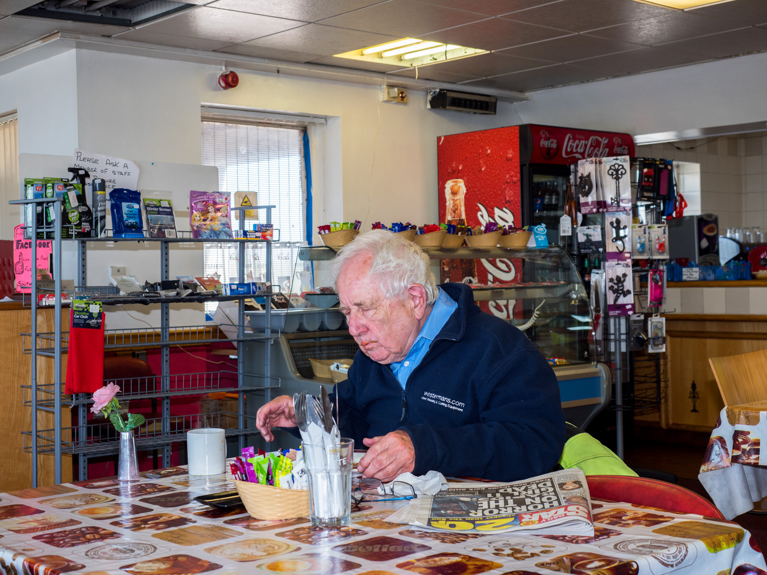 A customer at Flo's Cafe. Blyth, Nottinghamshire.