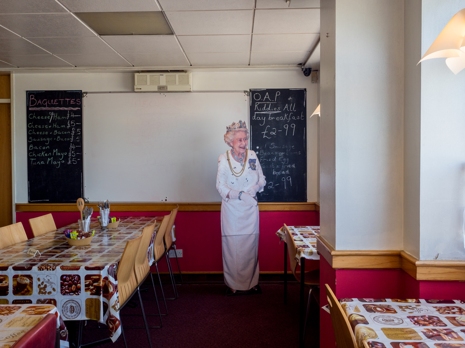 Cutomers at Flo's Cafe can get a photo taken with a cut out of the Queen. Blyth, Nottinghamshire.