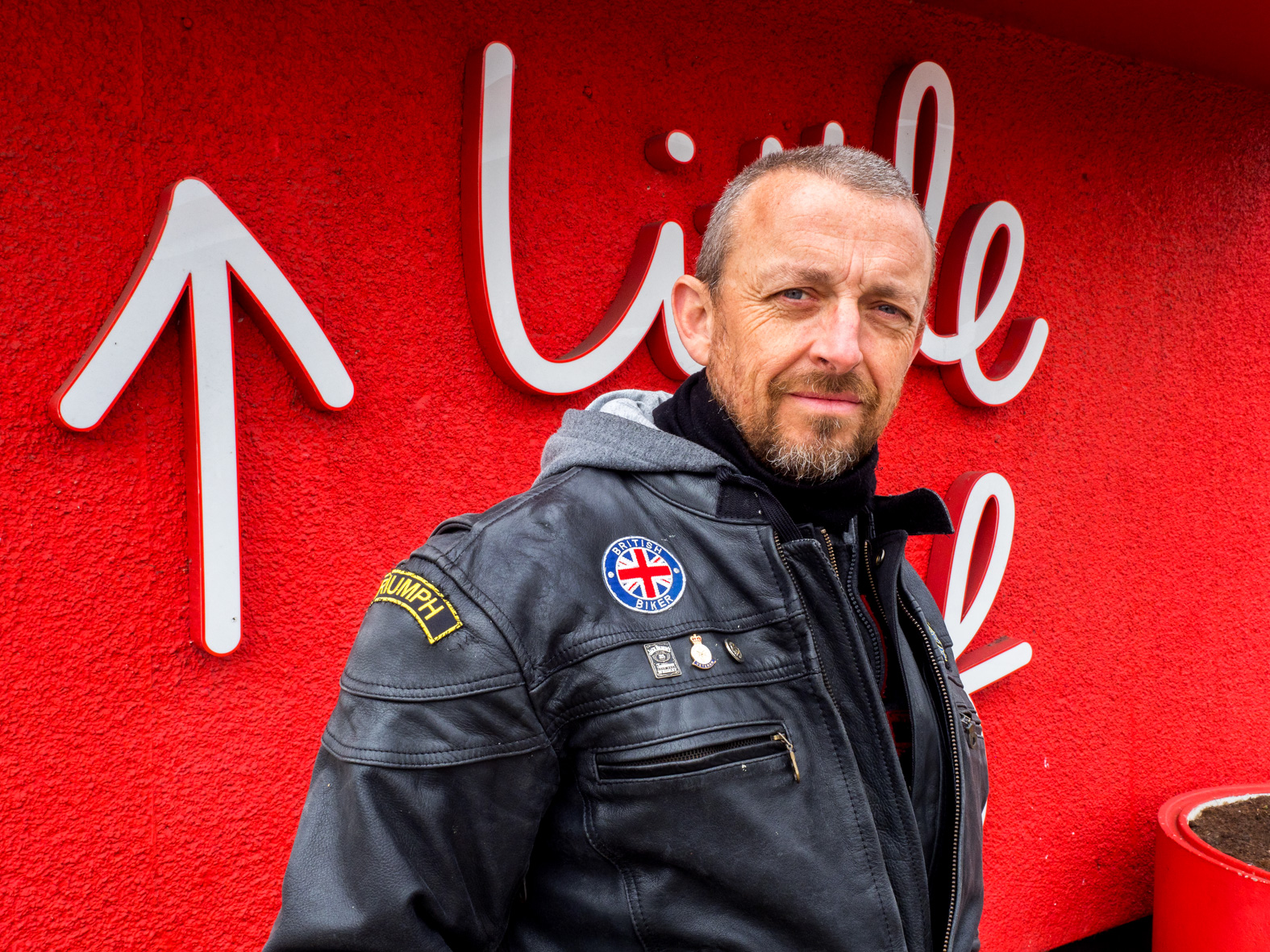 Dave waits for friends at Little Chef for a Sunday motorcycle ride. From Doncaster, he says the town has gone more upmarket. Dave who has invesmants in property and shares, voted remain in the 2016 European Union membership referendum. South Yorkshire.