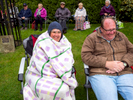 Members of the public wrap up warm while listening to an outdooe music performance. Wetherby, West Yorkshire.