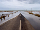 A road to the tidal island of Lindisfarne. Northumberland.