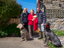 Richard, who works in the motor trade, with wife Helen, mother-in-law Iris and dogs Devon and Dragon on a walk on the tidal island of Lindisfarne. They are all Conservative Party voters and Iris is mayor of Frinton-on-Sea. Northumberland.
