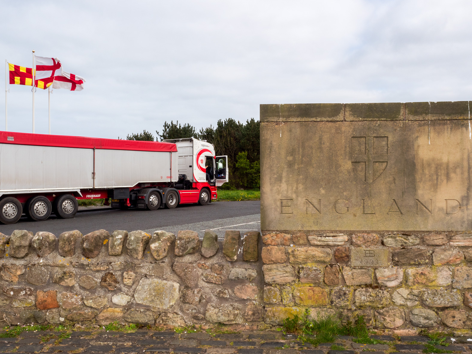 A truck parked at the England/Scotland border.