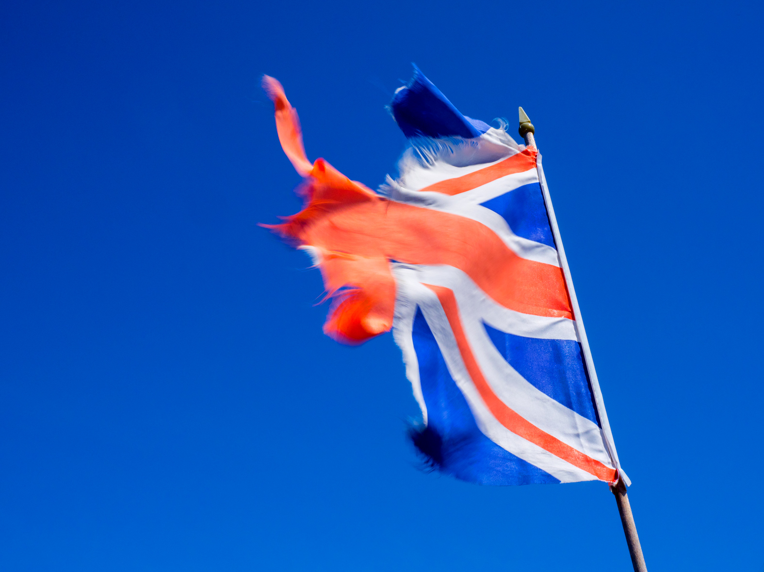 A tattered Union flag of Great britain.