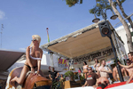 16:54 A participant rides the bucking bronco as part of a wet t-shirt competition hosted at Mambo's Terrace, Magaluf, Majorca. The competition included women from the British counties of Essex, Stafford and Yorkshire. The competition was eventually won by Monica, from Romania, who received the €100 cash prize.