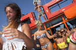 15:59 Girls enjoy an afternoon boat party for the many British seasonal bar workers and promoters in Ayia Napa, Cyprus.