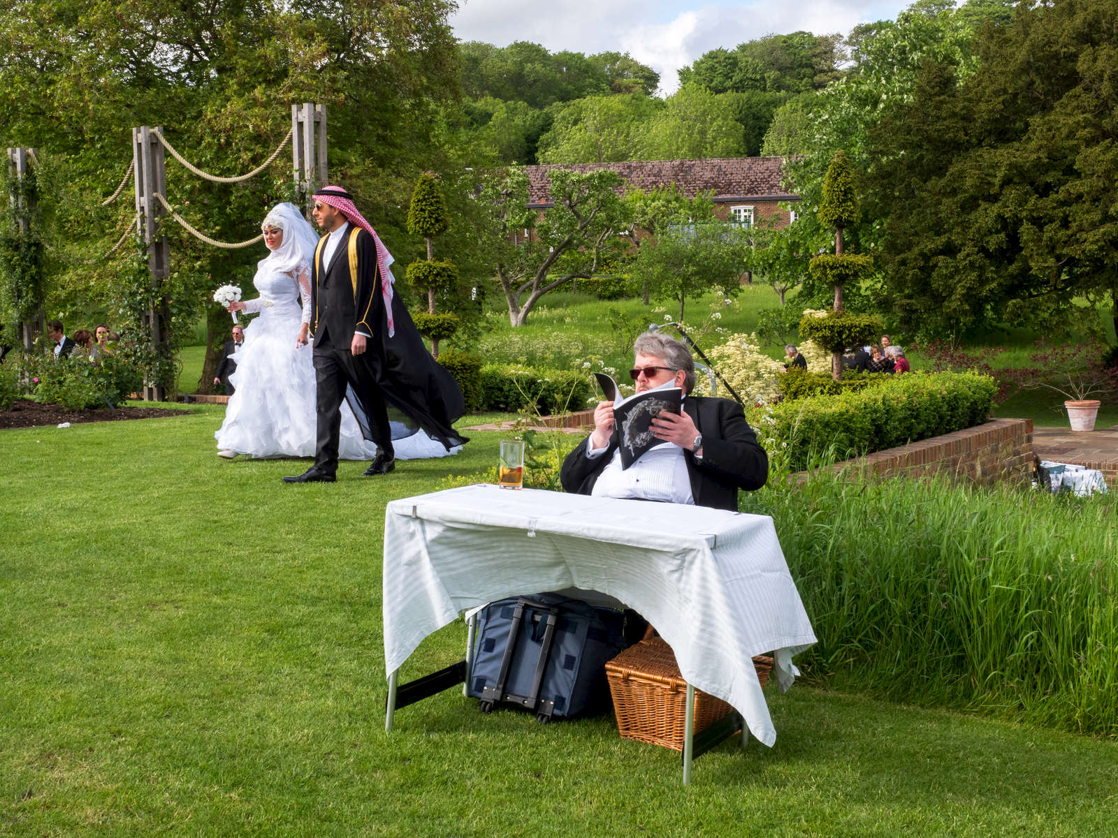 Performers from the opera, Hipermestra by Francesco Cavalli, mingle with visitors ahead of the evening performance. Glyndebourne is an English country house, the site of an opera house that, since 1934, has been the venue for the annual Glyndebourne Festival Opera.