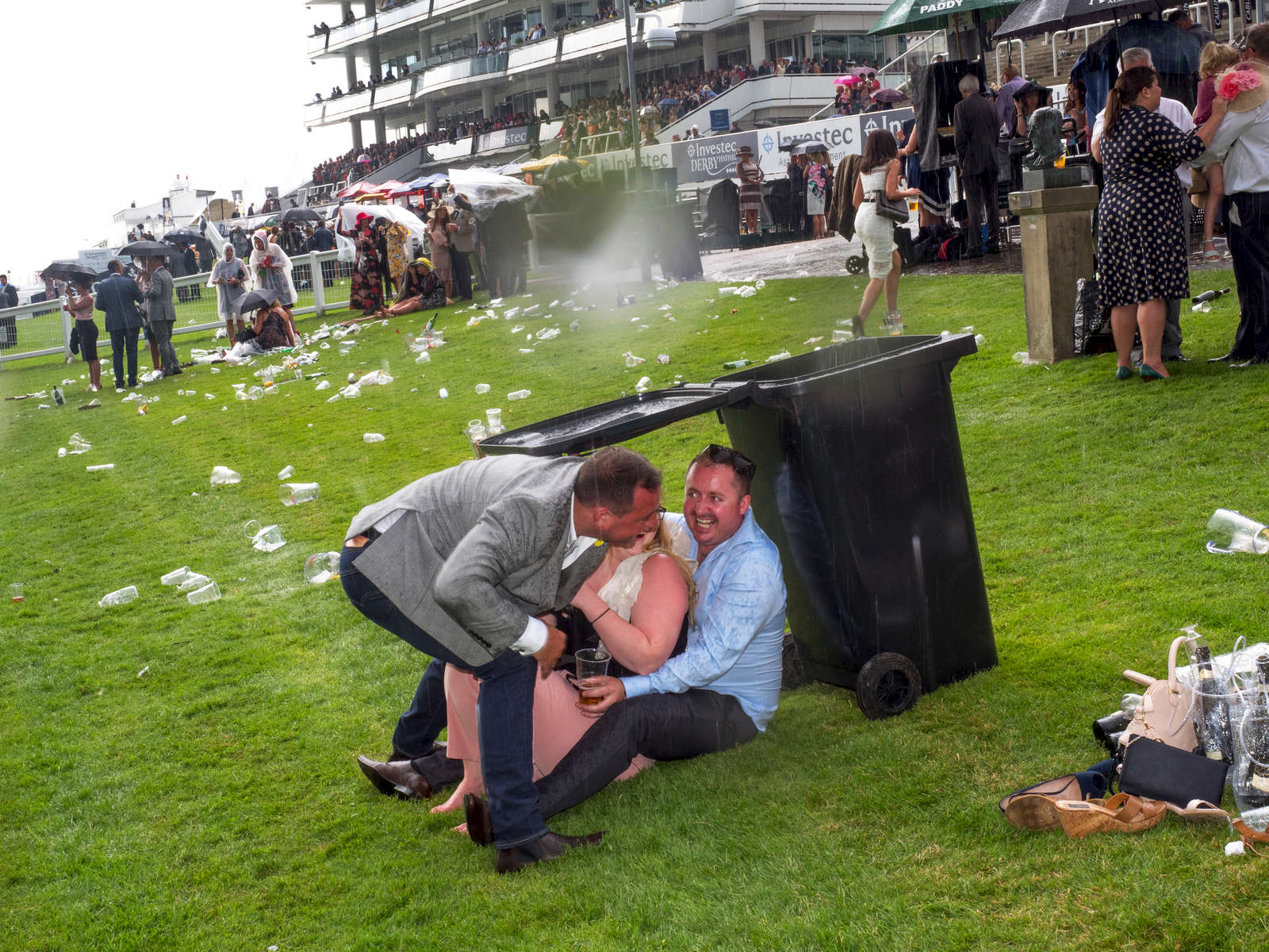 Visitor to Epsom take evasive action during a downpour.Ladies' Day is traditionally held on the first Friday of June, a multitude of ladies and gents head to Epsom Downs Racecourse to experience a day full of high octane racing, music, glamour and fashion.