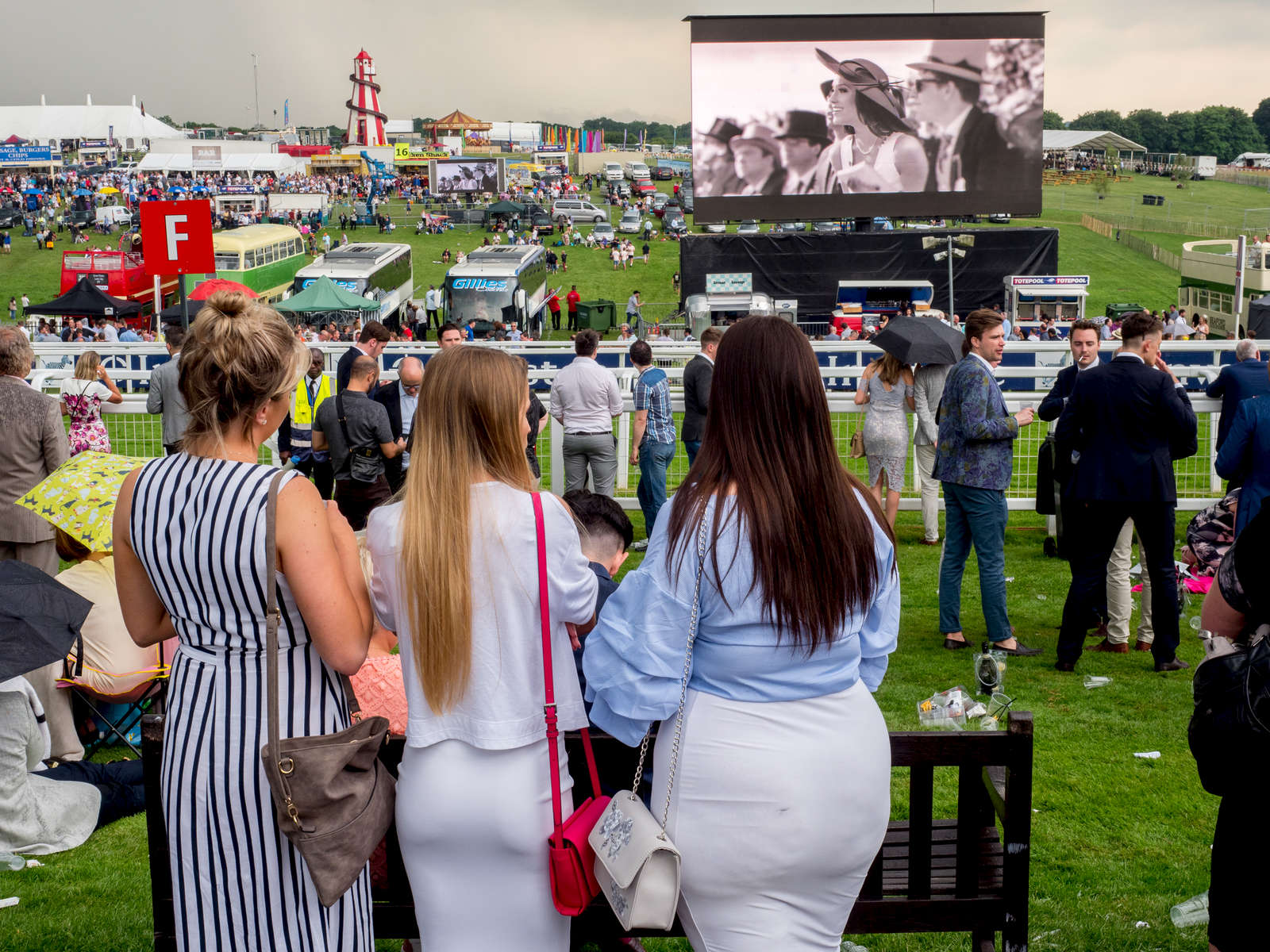Crowds gather to watch the horse racing on Ladies' Day at Epsom.Ladies' Day is traditionally held on the first Friday of June, a multitude of ladies and gents head to Epsom Downs Racecourse to experience a day full of high octane racing, music, glamour and fashion.