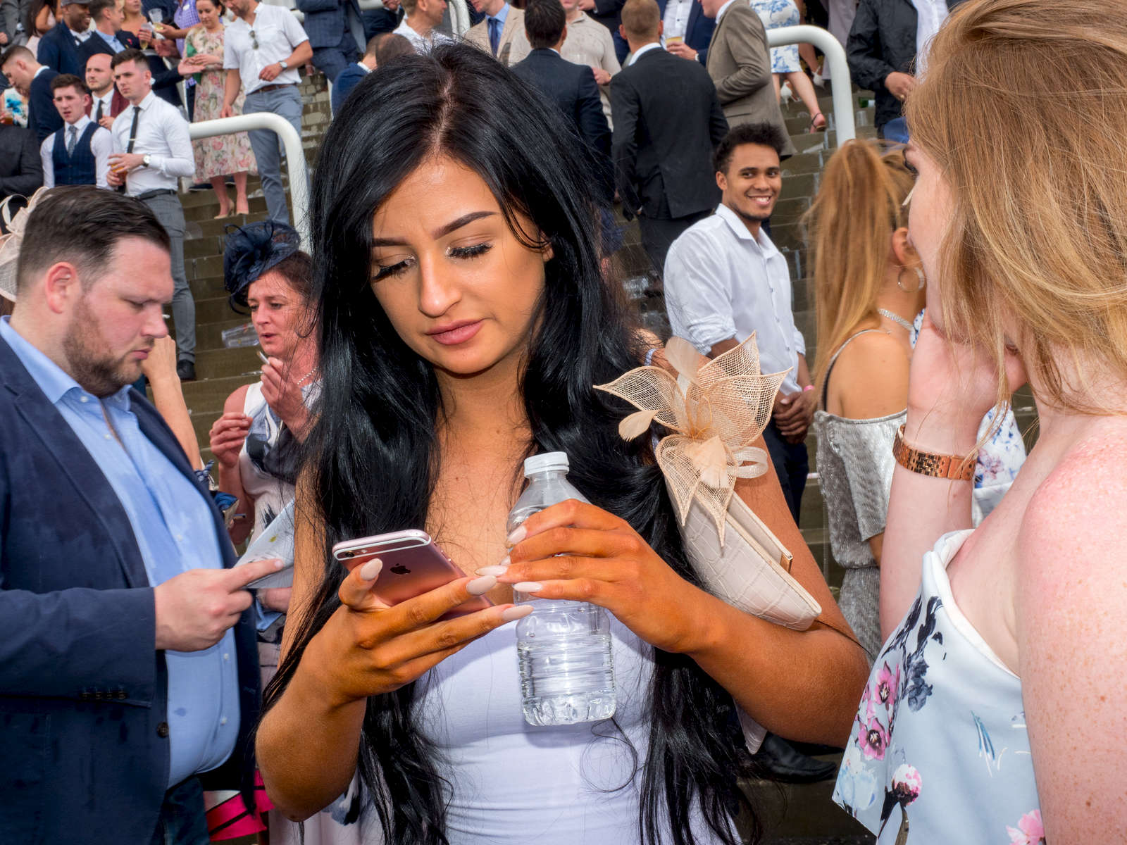 A young female visitor to Epsom shows evidence of using fake tan.Ladies' Day is traditionally held on the first Friday of June, a multitude of ladies and gents head to Epsom Downs Racecourse to experience a day full of high octane racing, music, glamour and fashion.