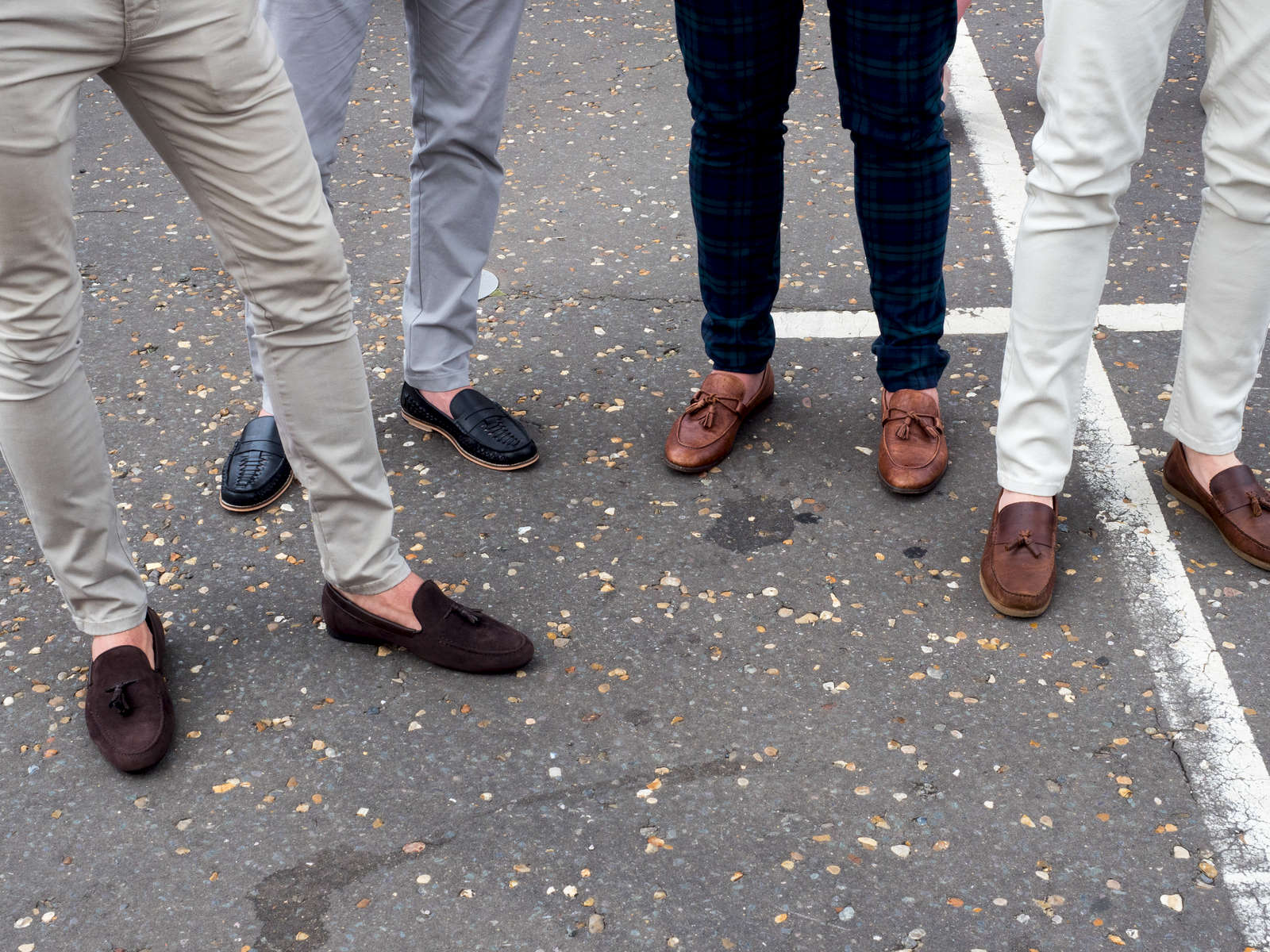 No socks and loafers is the fashion choice by one group of male friends on a day out at Epsom.Ladies' Day is traditionally held on the first Friday of June, a multitude of ladies and gents head to Epsom Downs Racecourse to experience a day full of high octane racing, music, glamour and fashion.