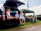 Young polo enthusiasts sit in the boot of a car.The 2017 Cartier Queen's Cup Final was played at the Guards Polo Club located in Windsor Great Park.