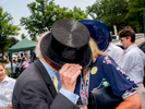 Peter McNally Esq doffs his top hat to greet one guest at a champagne luncheon prior to the Royal Ascot meting in the No 1 Car Park for guests of George & Tatiana Piskov & Liz Brewer.One of Britain's most well-known racecourses, Ascot holds a special week of races in June each year called Royal Ascot, attended by The Queen. The week has become Britain's most popular race meeting, welcoming around 300,000 visitors over five days, all dressed up in their finest clothes and hats.
