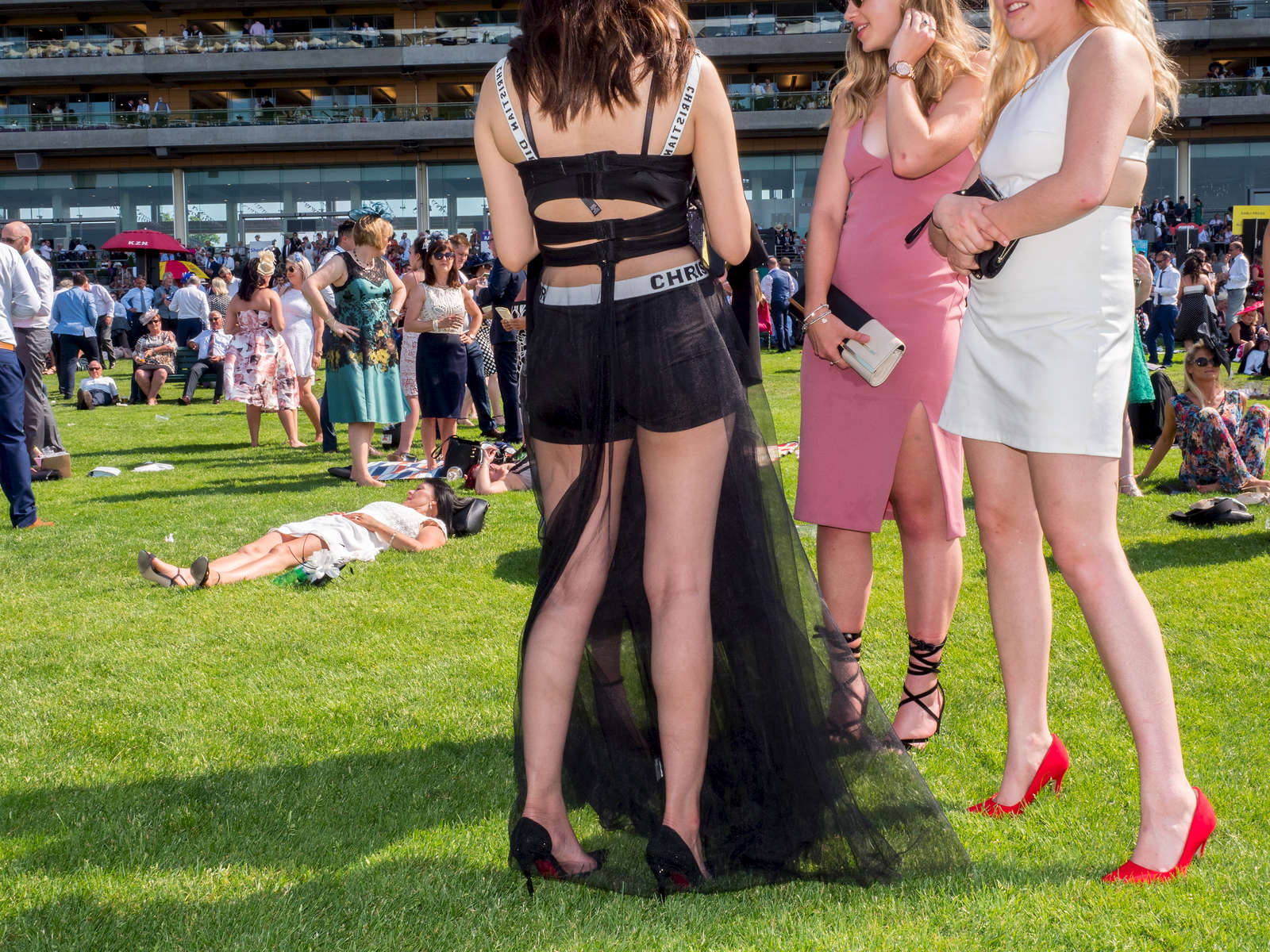 Woman chatter between the horse raing at Royal Ascot.One of Britain's most well-known racecourses, Ascot holds a special week of races in June each year called Royal Ascot, attended by The Queen. The week has become Britain's most popular race meeting, welcoming around 300,000 visitors over five days, all dressed up in their finest clothes and hats.