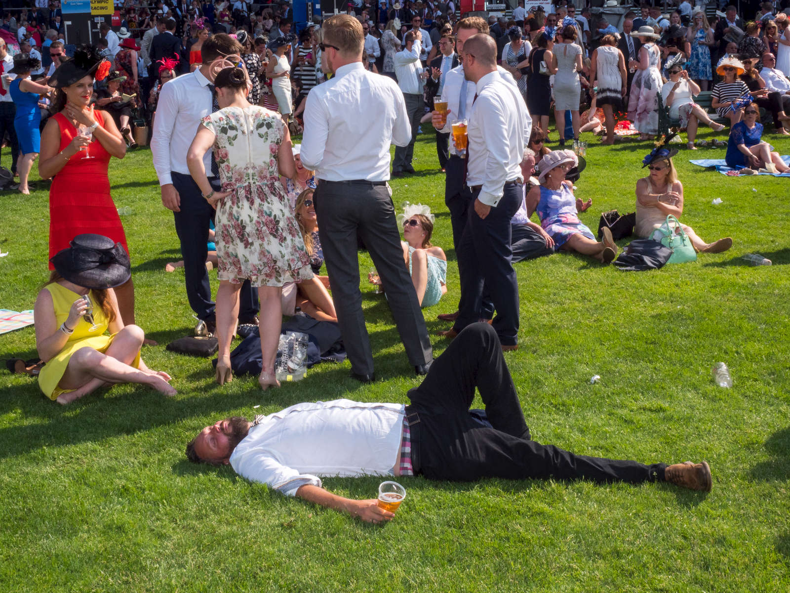 A man with his pint rests on the grass at Royal Ascot.One of Britain's most well-known racecourses, Ascot holds a special week of races in June each year called Royal Ascot, attended by The Queen. The week has become Britain's most popular race meeting, welcoming around 300,000 visitors over five days, all dressed up in their finest clothes and hats.