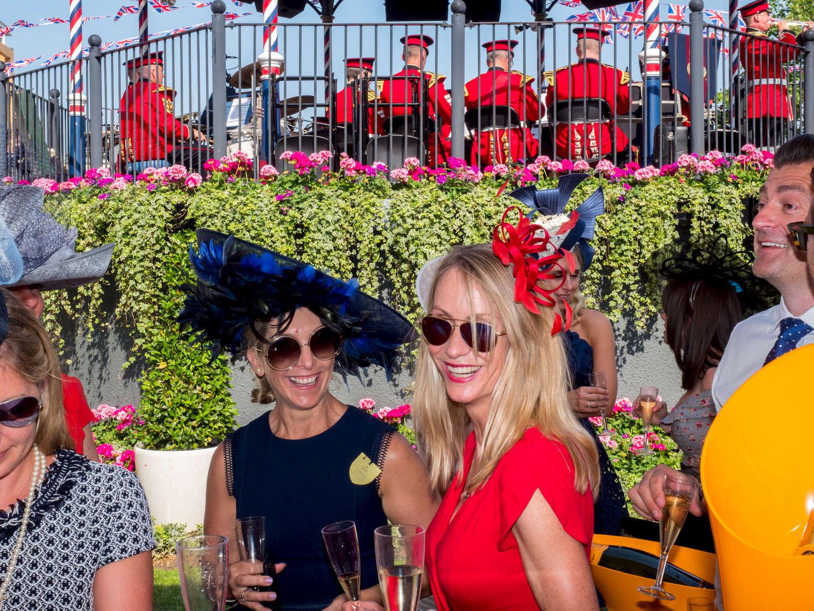 Visitors to the Veuve Clicquot bar located next to the bandstand at Royal Ascot.One of Britain's most well-known racecourses, Ascot holds a special week of races in June each year called Royal Ascot, attended by The Queen. The week has become Britain's most popular race meeting, welcoming around 300,000 visitors over five days, all dressed up in their finest clothes and hats.