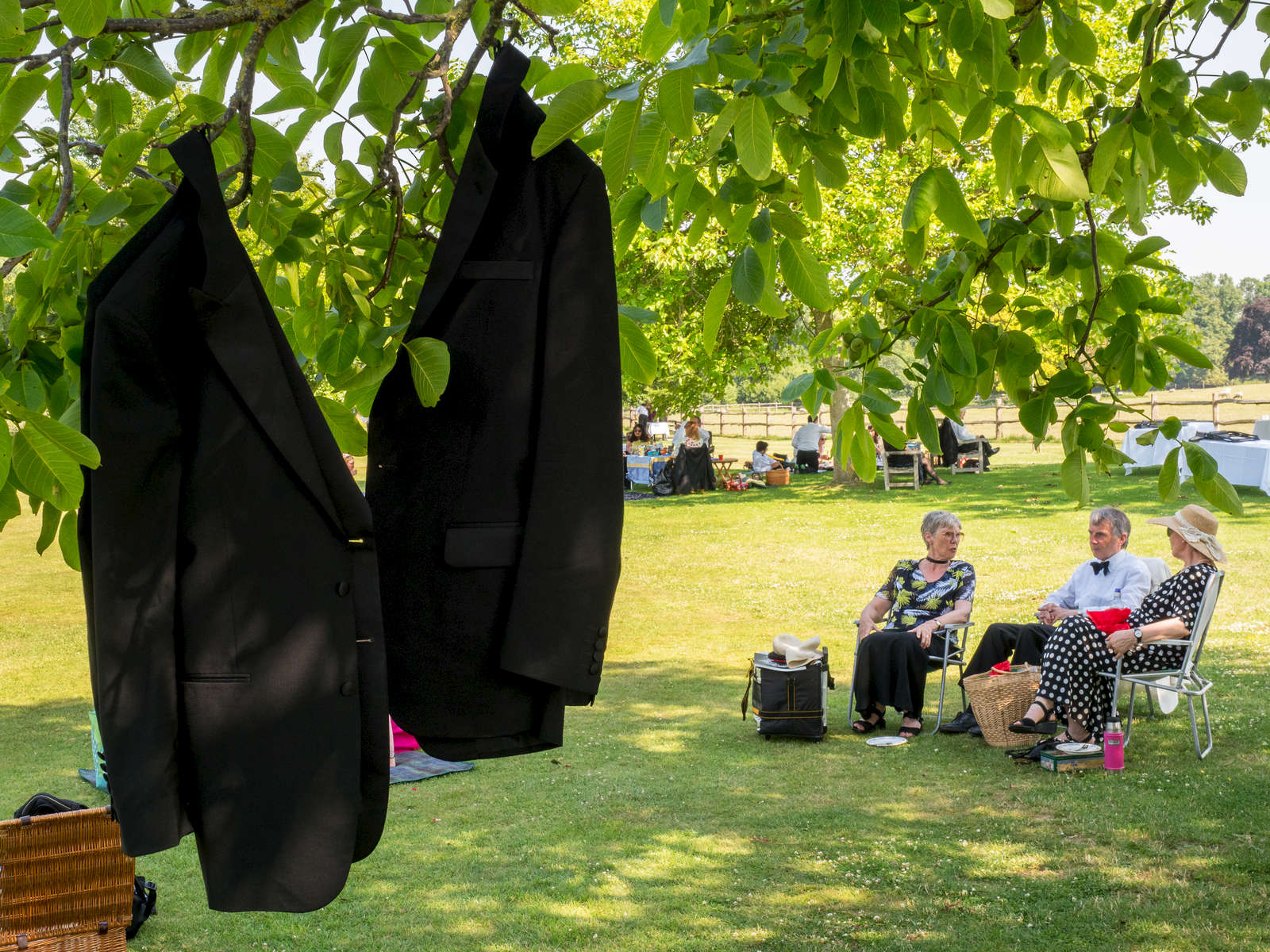 Opera enthusiasts picnic on the lawn at Glyndebourne's under-30s promotion night.Glyndebourne is an English country house, the site of an opera house that, since 1934, has been the venue for the annual Glyndebourne Festival Opera.