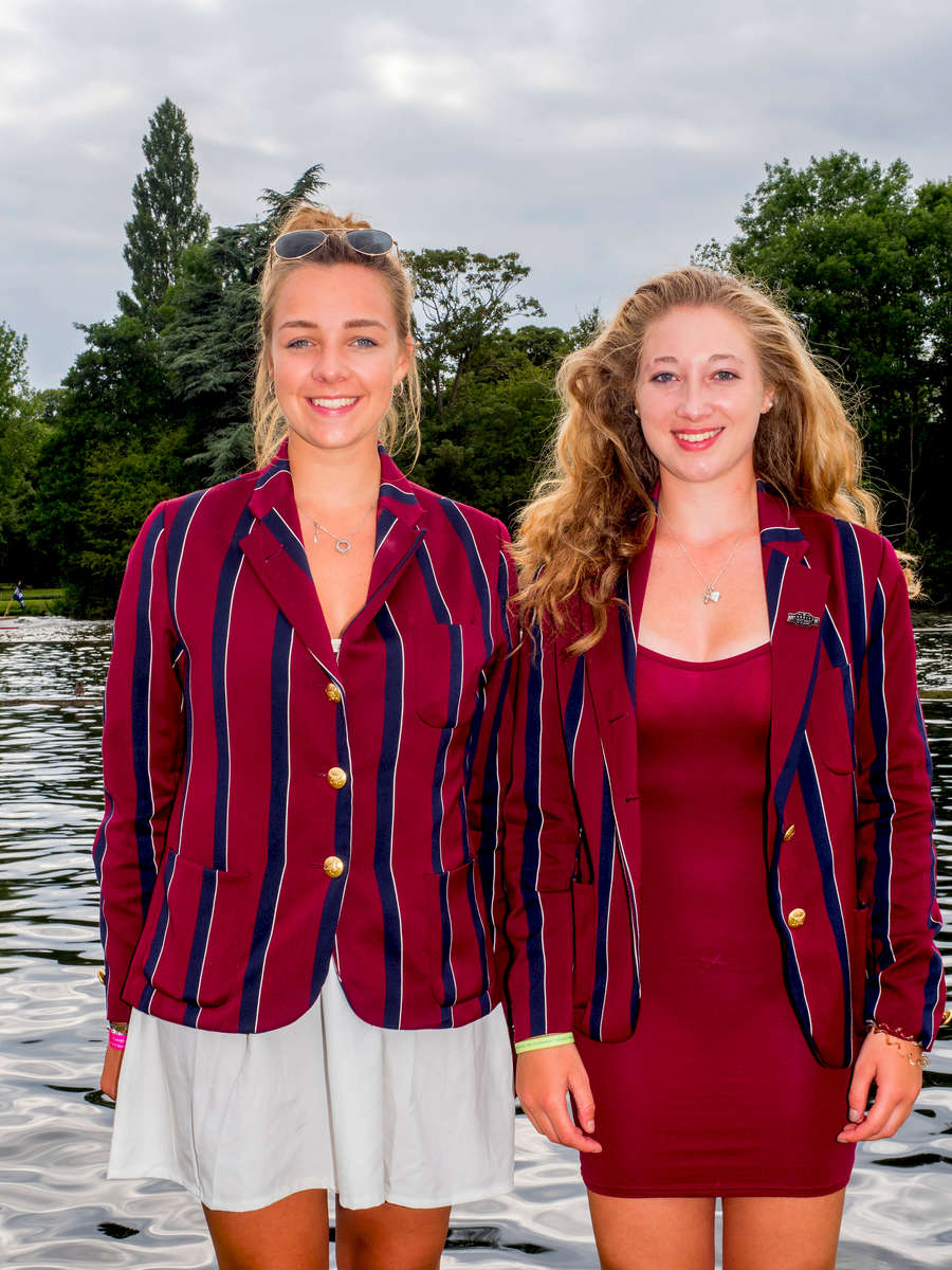 Georgie Lowe (left) and Lucy Walker, who row for Oxford Brookes University Boat Club, on the bank of the Thames at the Henley Royal Regatta.Henley Royal Regatta is a rowing event held annually on the River Thames by the town of Henley-on-Thames, England. It was established on 26 March 1839.