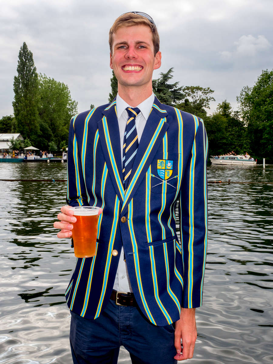 Simon Todd wearing the blazer of RUMSBC, a mixed club that rows from the University of London boathouse on the river Thames, at the Henley Royal Regatta, a rowing event held annually on the River Thames by the town of Henley-on-Thames, England. It was established on 26 March 1839.