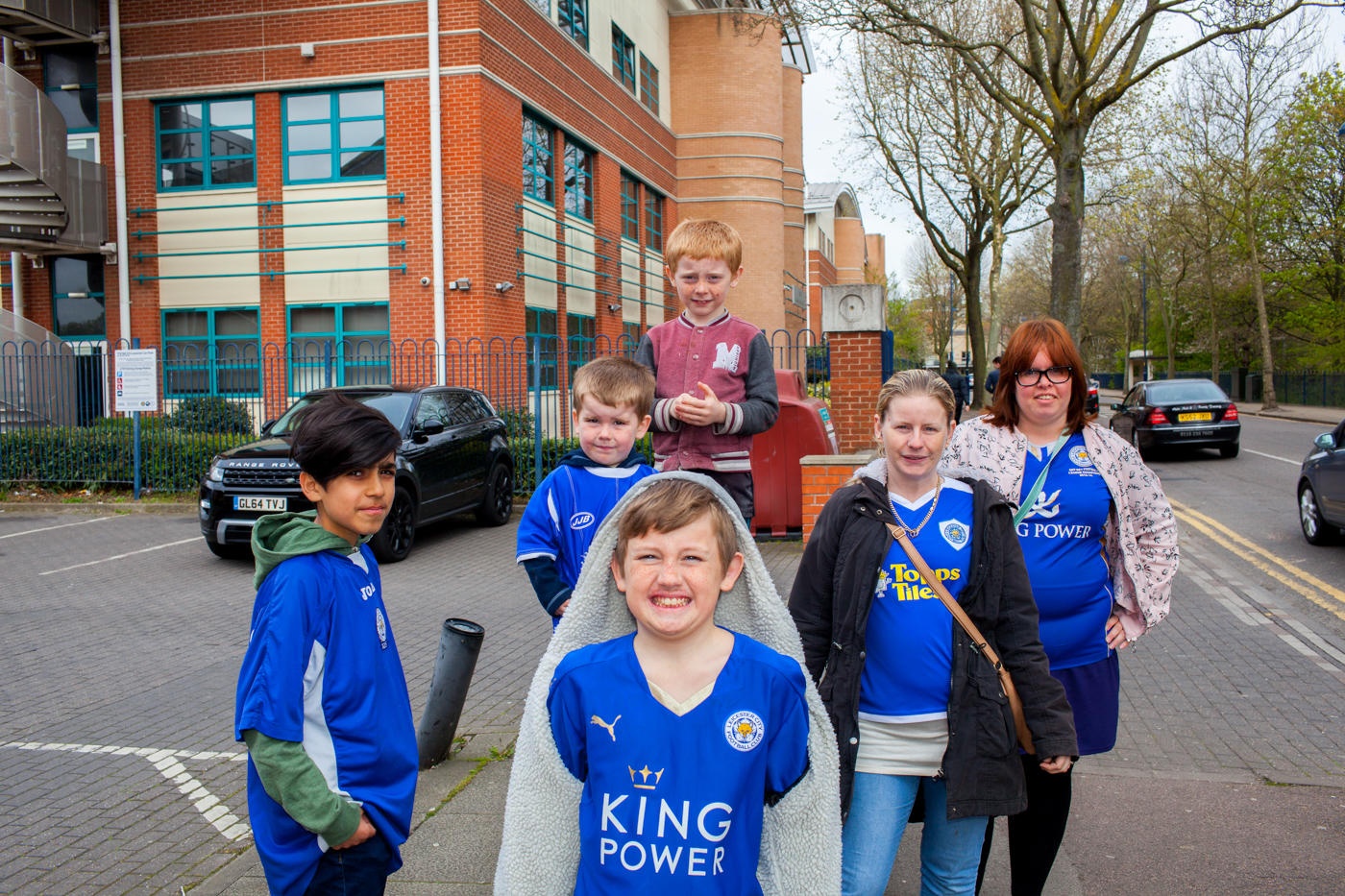 LEICESTER, UK MAY 2016Liz Atkins with her three children, Tyler 11 (front), Fidian 8 (back) and Aire 3 (middle) with friend Jessica Ray and Nima (far left) on their way to the Soar Point pub in Leicester to watch them play Manchester United on television.On the 2nd May 2016, Leicester City football club became champions of England for the first time in their 132 year history.Leicester has been dubbed as most multicultural diversified city in England, thanks to scores of people that have flocked the city and who have hailed from different parts of the world. According to the Leicester city council, the city has the highest number of immigrants who have sought both temporary and permanent residence in England. Majority of these immigrants are people who have left their home countries in pursuit of job opportunities in England.  Photo byPeter Dench/Getty Images Assignment forESPN