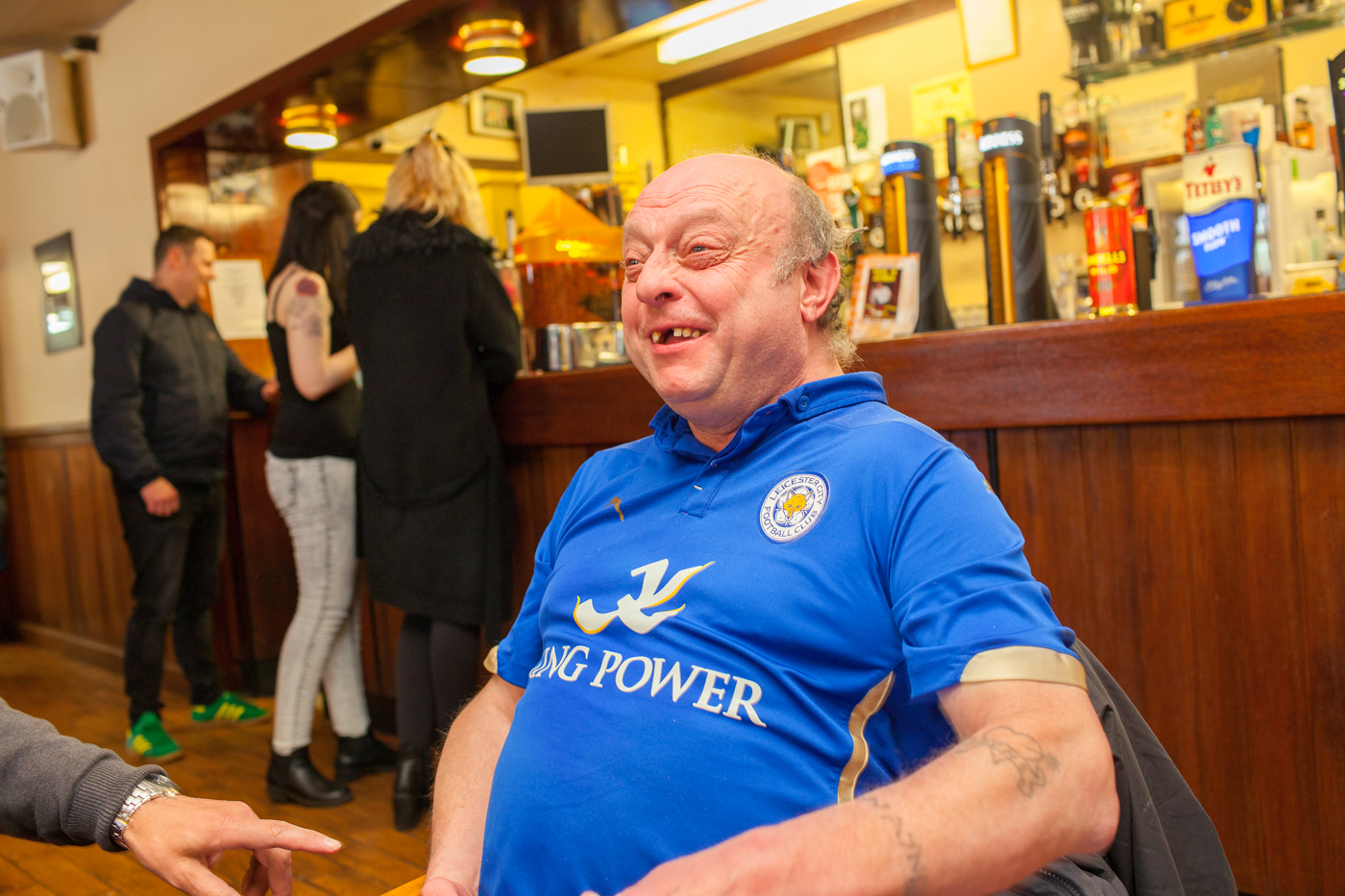 LEICESTER, UK MAY 2016Leicester city fans drinking in the West End Working Men's Club in the city.On the 2nd May 2016, Leicester City football club became champions of England for the first time in their 132 year history.Leicester has been dubbed as most multicultural diversified city in England, thanks to scores of people that have flocked the city and who have hailed from different parts of the world. According to the Leicester city council, the city has the highest number of immigrants who have sought both temporary and permanent residence in England. Majority of these immigrants are people who have left their home countries in pursuit of job opportunities in England.  Photo by Peter Dench/Getty Images Assignment for ESPN