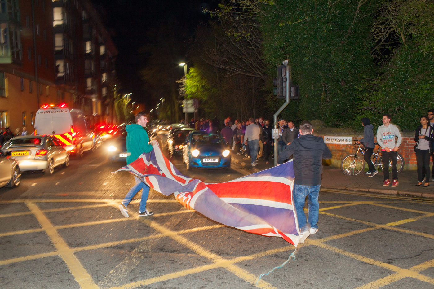 LEICESTER, UK MAY 2016Leicester City football fans carry a Union Flag through the street.On the 2nd May 2016, Leicester City football club became champions of England for the first time in their 132 year history.Leicester has been dubbed as most multicultural diversified city in England, thanks to scores of people that have flocked the city and who have hailed from different parts of the world. According to the Leicester city council, the city has the highest number of immigrants who have sought both temporary and permanent residence in England. Majority of these immigrants are people who have left their home countries in pursuit of job opportunities in England.  Photo by Peter Dench/Getty Images Assignment for ESPN