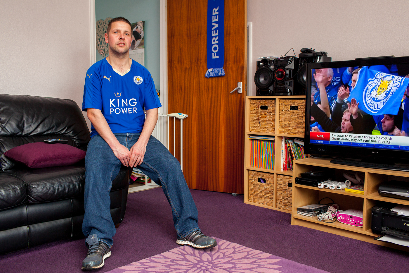 LEICESTER, UK MAY 2016Craig Sawbridge, a Leicester City fanatic at his home in the city.On the 2nd May 2016, Leicester City football club became champions of England for the first time in their 132 year history.Leicester has been dubbed as most multicultural diversified city in England, thanks to scores of people that have flocked the city and who have hailed from different parts of the world. According to the Leicester city council, the city has the highest number of immigrants who have sought both temporary and permanent residence in England. Majority of these immigrants are people who have left their home countries in pursuit of job opportunities in England.  Photo byPeter Dench/Getty Images Assignment forESPN