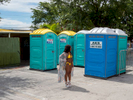 A woman waits by the toilet at a pool party in the Sweetwater district of Miami.Miami is a seaport city on the Atlantic Ocean in south Florida. Miami's metro area is the eighth-most populous and fourth-largest urban area in the U.S., with a population of around 5.5 million.Miami is a major center, and a leader in finance, commerce, culture, media, entertainment, the arts, and international trade. In 2008, Forbes magazine ranked Miami {quote}America's Cleanest City{quote}, for its year-round good air quality, vast green spaces, clean drinking water, clean streets, and city-wide recycling programs. According to a 2009 UBS study of 73 world cities, Miami was ranked as the richest city in the United States, and the world's fifth-richest city in terms of purchasing power. Miami is nicknamed the {quote}Capital of Latin America{quote}, is the second largest U.S. city with a Spanish-speaking majority, and the largest city with a Cuban-American plurality.©Peter Dench/Getty Images Reportage